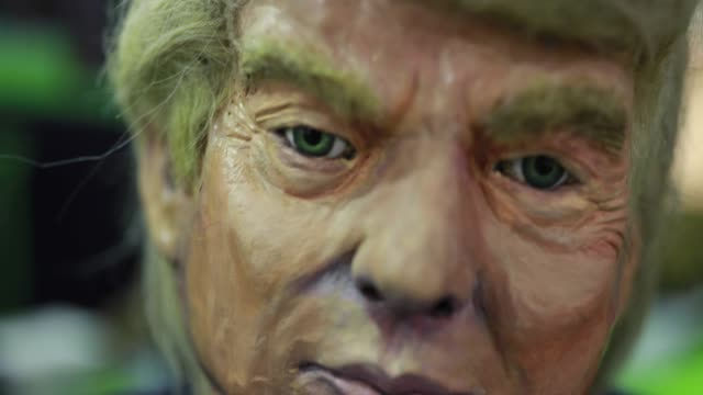 A papiermâché replica of United States President Donald J Trump is on display at the Durkin Tactical booth being prepared for the NRA convention The...