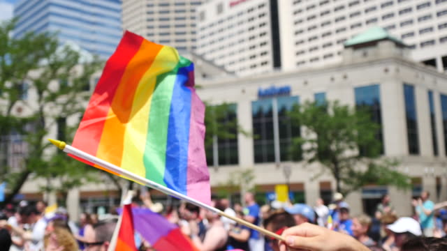 indianapolis, indiana, usa: a person waves a rainbow flag. members of the lgbtq community and their allies gather to rally at monument circle in... - rainbow flag stock videos & royalty-free footage