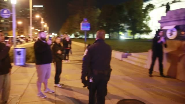 vídeos de stock, filmes e b-roll de after an antitrump rally on the south steps of the indiana statehouse protesters march and hold signs against united states president elect donald... - manifestante