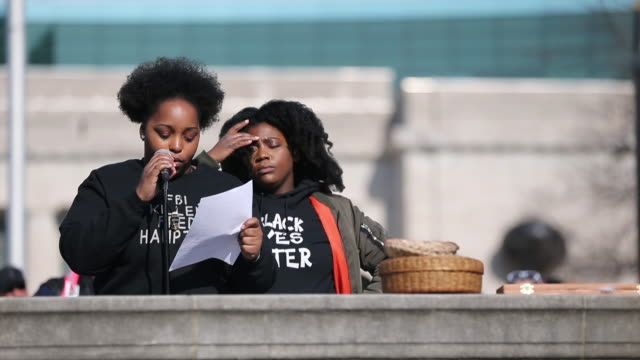 leah humphrey and kyra harvey community activists for indy 10 black lives matter speak as women gather before marching on the first anniversary of... - marching stock videos & royalty-free footage