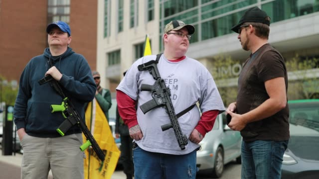 """indianapolis, indiana, usa: members of a iii percent militia act as a security force during a """"pro-freedom"""" rally at the indiana statehouse in... - percentage sign stock videos & royalty-free footage"""