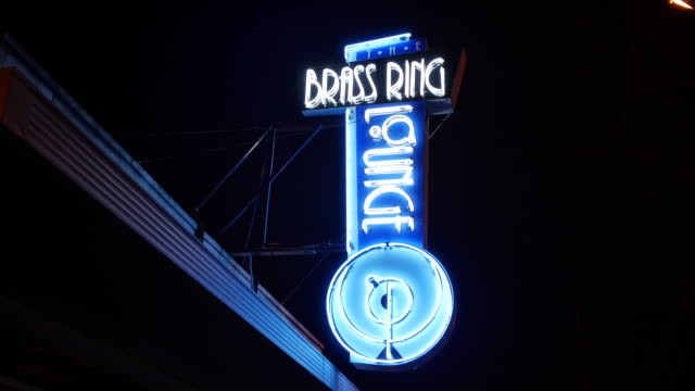 neon light outside the brass ring lounge in the fountain square neighborhood of indianapolis - indianapolis stock videos & royalty-free footage