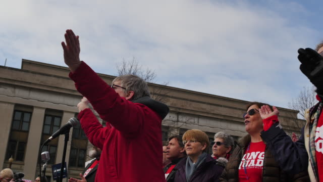 pam blevinshinkle leads chants into the beginning of the march to the indiana statehouse during the 2018 women's march on the first anniversary of... - women's issues stock videos & royalty-free footage