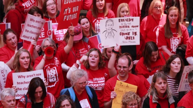 Teachers and supporters chant What do we want fair pay When do we want it now during the the Red for Ed Rally at the Indiana Statehouse Saturday...