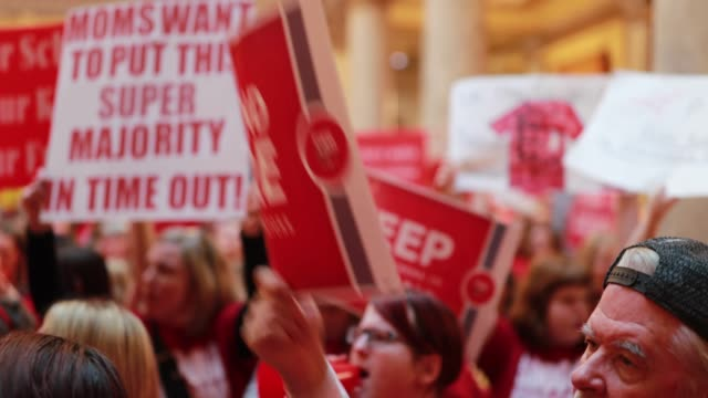 stockvideo's en b-roll-footage met teachers and supporters pack the indiana statehouse for the red for ed rally saturday march 9 2019 the teachers are demanding higher pay and more... - vakbond