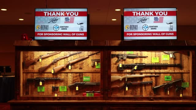 indianapolis, indiana, usa: the wall of guns, which is an nra fundraiser with tickets for a raffle is a fundraiser during the national rifle... - 全米ライフル協会点の映像素材/bロール