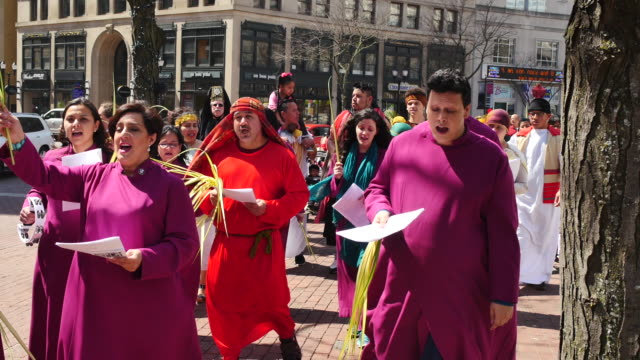 Worshippers at the Spanish language religious service at Christ Church Cathedral participate in a Palm Sunday procession on Monument Circle in...