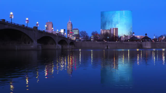 indianapolis skyline along the white river - indiana stock videos & royalty-free footage