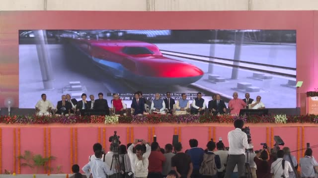 India's first bullet train project a $19 billion initiative linking Ahmedabad to Mumbai is launched as Indian Prime Minister Narendra Modi and...