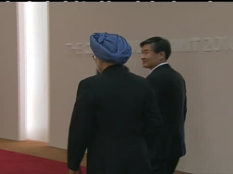of india's prime minister manmohan singh arriving and being greeted at the 2010 g20 summit in seoul. g20 summit that occurred in 2010 took place in... - (war or terrorism or election or government or illness or news event or speech or politics or politician or conflict or military or extreme weather or business or economy) and not usa stock videos & royalty-free footage