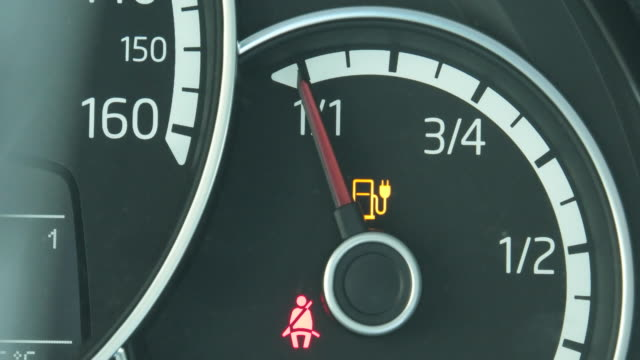 indicator light and needle on the dashboard indicating that the batteries are full charged. - dashboard stock videos & royalty-free footage