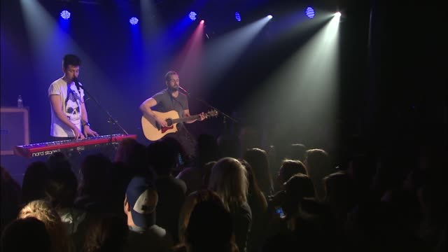 indie rock group bastille changed things up when they played an acoustic set with limited synths for a special performance at the jbtv studio /... - evento in diretta video stock e b–roll