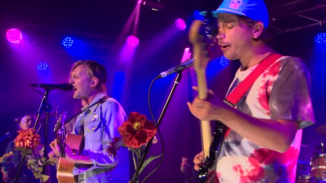 vídeos y material grabado en eventos de stock de indie rock group waters played a special guest performance of their song 'over it' on a flowercovered stage at jbtv studios - montaje documental