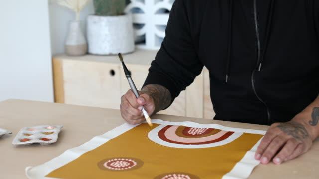 indigenous aboriginal australian artist painting in studio - minority groups stock videos & royalty-free footage
