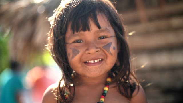 indigenous brazilian child, portrait from tupi guarani ethnicity - traditional clothing stock videos & royalty-free footage