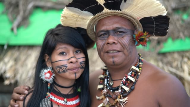 indigenous brazilian mature man and her daughter from guarani ethnicity - north american tribal culture stock videos & royalty-free footage