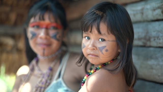 indigenous brazilian sisters, portrait from tupi guarani ethnicity - indigenous culture stock videos & royalty-free footage