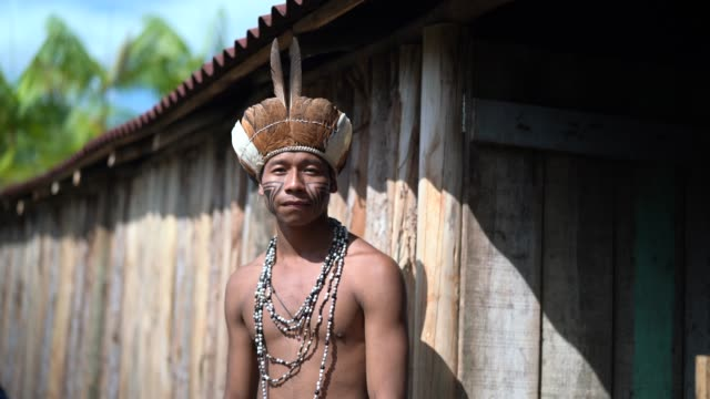 indigenous brazilian young man portrait from guarani ethnicity at home - indigenous culture stock videos & royalty-free footage