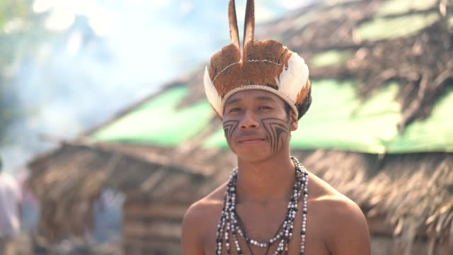 indigenous brazilian young man portrait from guarani ethnicity - indigenous culture stock videos & royalty-free footage