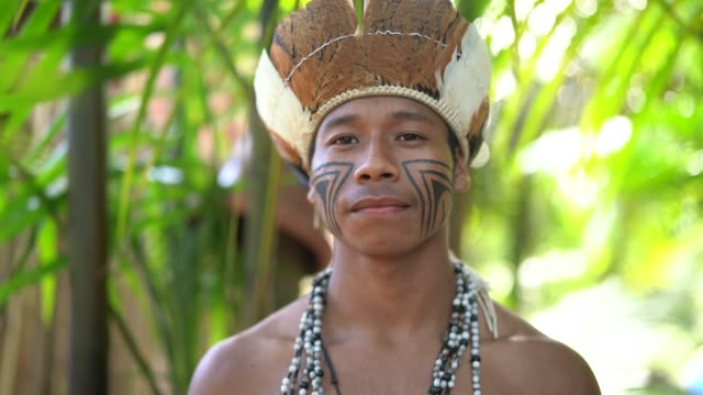 indigenous brazilian young man portrait from guarani ethnicity - brazilian ethnicity stock videos & royalty-free footage