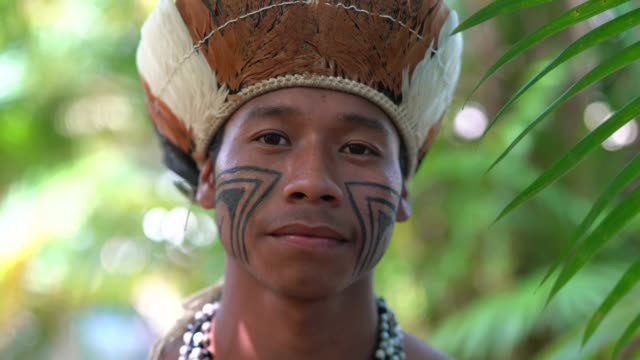 indigenous brazilian young man portrait from guarani ethnicity - indigenous north american culture stock videos & royalty-free footage
