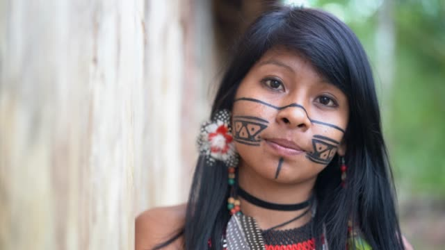 indigenous brazilian young woman, portrait from guarani ethnicity - traditional clothing stock videos & royalty-free footage