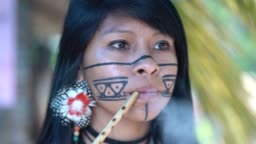 Indigenous Brazilian Young Woman Smoking Pipe, from Guarani Ethnicity