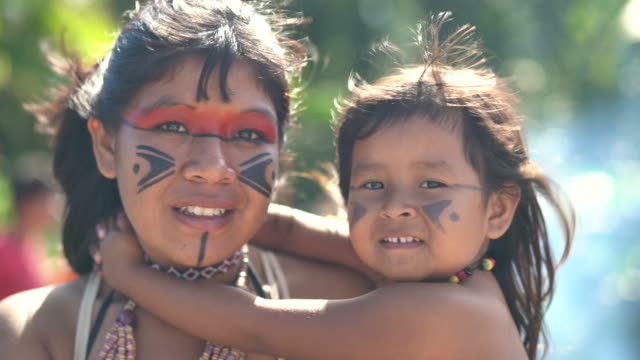 indigenous brazilian young women and her child, portrait from tupi guarani ethnicity - indigenous culture stock videos & royalty-free footage