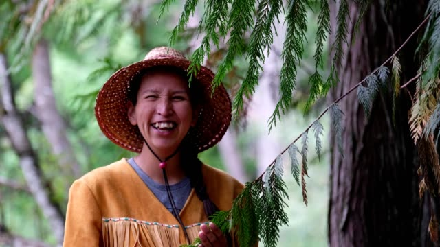 indigenous canadian woman blessing the trees - traditionally canadian stock videos & royalty-free footage