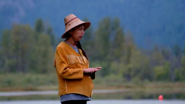 indigenous canadian woman blessing the water - native american ethnicity stock videos & royalty-free footage
