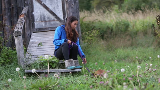 indigenous canadian woman playing with her pet dog - indigenous north american culture stock videos and b-roll footage