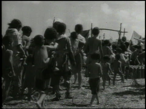 indigenous chamorro people walking w/ us 2nd marine division soldier child being carried children standing together in refugee camp children other... - saipan stock videos and b-roll footage