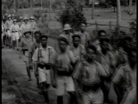 indigenous melanesian men in free french uniforms walking roadway. indigenous melanesian bugler, men training running down, up hillside paths.... - oceania stock videos & royalty-free footage