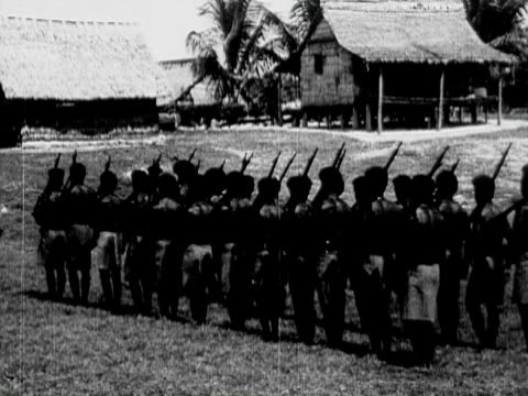 1934 B/W MONTAGE MS WS CU Indigenous men marching and drilling with rifles, portraits of various men with facial piercing and adornments / Solomon Islands