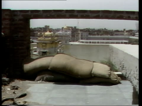 history of sikh troubles lib / 361984 india punjab amritsar roof of golden temple pull back temple and lake ms sandbags on flat roof of bldg against... - indira gandhi stock videos & royalty-free footage