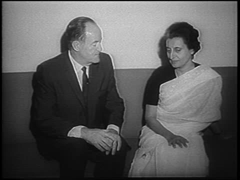 indira gandhi sitting talking with hubert humphrey / newsreel - indira gandhi stock videos & royalty-free footage