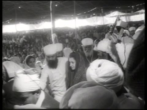 b/w indira gandhi walking with sikh bodyguards / 1960's / sound - indira gandhi stock videos & royalty-free footage
