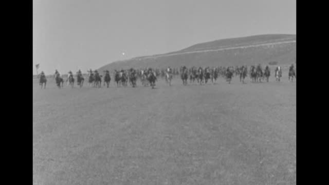 indistinct shot / line of us cavalrymen galloping along top of ridge / group of cavalry galloping towards and past camera / group of cavalry... - cavalry stock videos & royalty-free footage