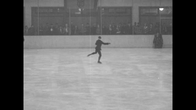 indistinct shot / us figure skater gail borden performing figure skating routine in olympic arena / note exact day not known - 1932 winter olympics lake placid stock videos and b-roll footage