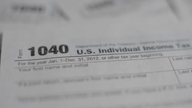 stockvideo's en b-roll-footage met individual income tax forms taxes tax forms on april 11 2013 in tiskilwa illinois - tax