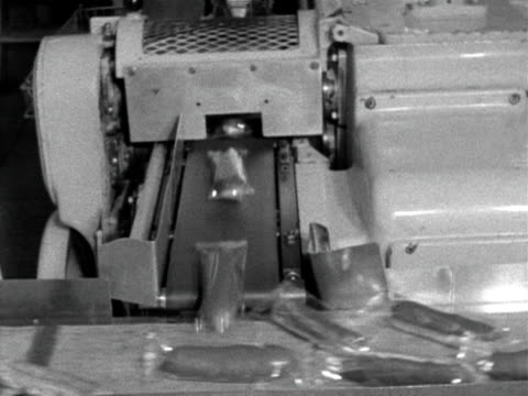 individually wrapped chocolate eclairs move along a conveyer belt at the birds eye factory 1962 - cellophane stock videos and b-roll footage
