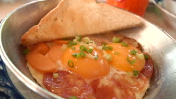 Indochinese pan fried eggs, Sprinkled with chinese sausages and vegetables.