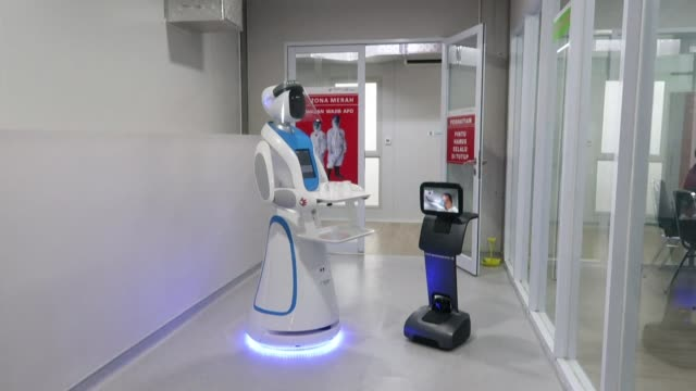 vídeos de stock e filmes b-roll de indonesia is rolling out droids that can make hospital food deliveries and at-a-distance health checks on coronavirus patients, marking the latest... - indonesia