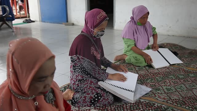 indonesian blind reads the koran with braille characters during the holy fasting month of ramadan in medan on april 15 north sumatra, indonesia.... - braille stock videos & royalty-free footage