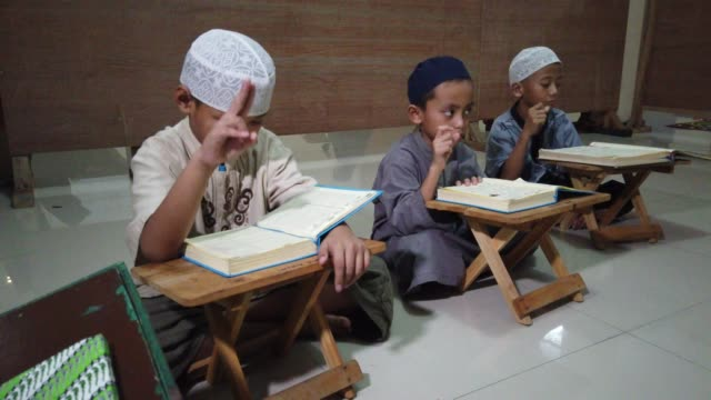 indonesian deaf students, also known as 'santri' read quran at the islamic deaf boarding school darul ashom during the holy month of ramadan amid the... - deafness stock videos & royalty-free footage