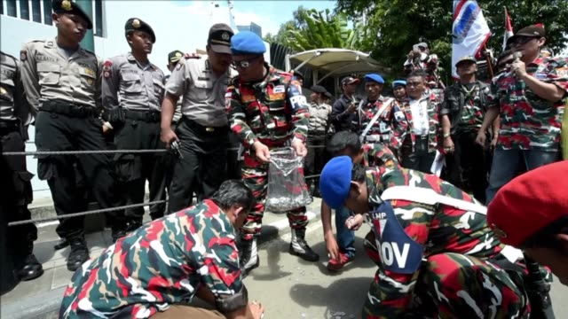 indonesian demonstrators tuesday delivered bags of coins to the australian embassy saying they were handing back tsunami aid money after canberra... - financial item stock videos & royalty-free footage