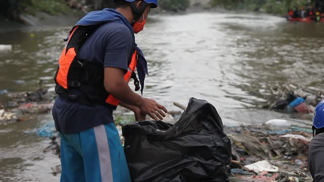 indonesian environmental activists collect plastic waste that has pooled in the deli river basin during world environment day on june 5, 2021 in... - albert damanik stock videos & royalty-free footage