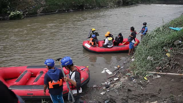 indonesian environmental activists prepare their boats to collect plastic waste that has pooled in the deli river basin during world environment day... - albert damanik stock videos & royalty-free footage