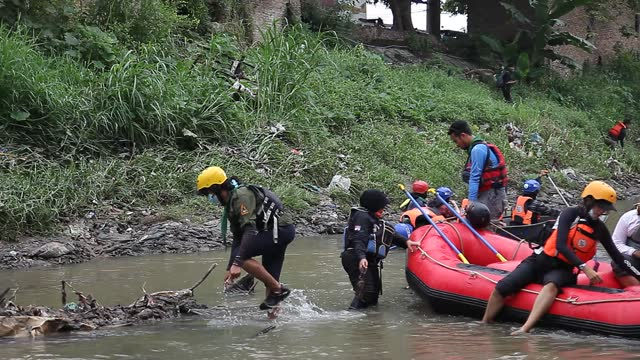 indonesian environmental activists use their boats to collect plastic waste that has pooled in the deli river basin during world environment day on... - albert damanik stock videos & royalty-free footage