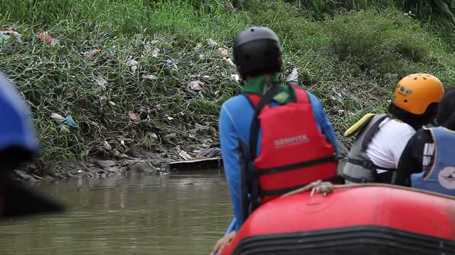 indonesian environmental use their boats to collect plastic waste along the deli river basin during world environment day on june 5, 2021 in medan,... - albert damanik stock videos & royalty-free footage